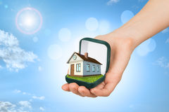 Empty ring box with brown house in humans hand Stock Images