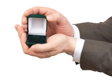 Empty ring box in businessmans hands Stock Image