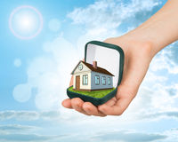 Empty ring box with house in arm Stock Photo