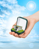 Empty ring box with house in hand Stock Images