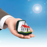 Empty ring box with house in man hand Stock Photography
