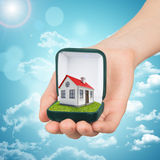 Empty ring box with house in womans hand Royalty Free Stock Image
