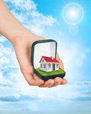 Empty ring box with red house in humans hand Royalty Free Stock Photo