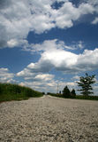 Empty Road. Long empty road and clouds stock photography