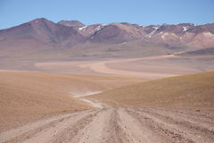 Empty road in Atacama Desert in Bolivia Stock Images
