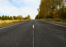 Empty road in the autumn landscape