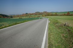 An empty road in autumn time, South Moravia. A romantic picture of empty road in autumn time, South Moravia, Czech Republic Royalty Free Stock Photography