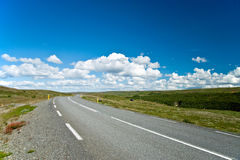 Empty road with a beautiful blue sky in horizon Royalty Free Stock Photo