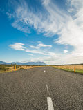 Empty road with a blue cloudy sky, Iceland Stock Photos