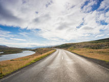 Empty road with a blue cloudy sky, Iceland Stock Images