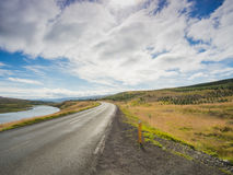 Empty road with a blue cloudy sky, Iceland Royalty Free Stock Images