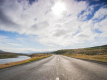 Empty road with a blue cloudy sky, Iceland Royalty Free Stock Photos
