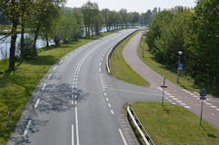 Empty Road And Bycicle Path. Photographed in The Netherlands. In Between of the city of Diemen and Driemond. It is called the Provinciale Weg Royalty Free Stock Photo