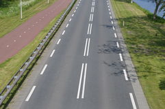 Empty Road And Bycicle Path. Photographed in The Netherlands. In Between of the city of Diemen and Driemond. It is called the Provinciale Weg Royalty Free Stock Images