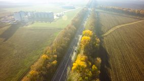 Empty road for cars aerial view from top around green nature.  stock photos