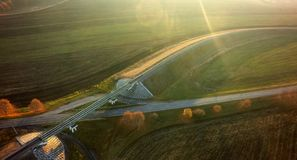 Empty road for cars aerial view from top around green nature.  stock images