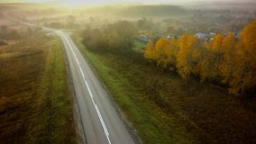 Empty road for cars aerial view from top around green nature.  royalty free stock photo