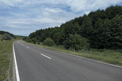 Empty road for cars around green nature.  Royalty Free Stock Images