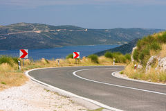 Empty road close to the beautiful seaside Royalty Free Stock Photo
