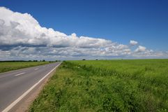 Empty road with clouds above Royalty Free Stock Image