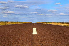 Empty road with clouds Royalty Free Stock Image