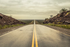 Empty road with clouds Stock Photography