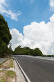 Empty road. Cloudy sky over an empty road Royalty Free Stock Image