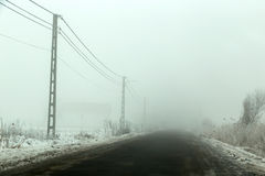 Empty road in a cold foggy winter day Stock Image