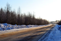 Empty road in country, Russia, winter. Royalty Free Stock Image