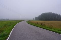 Empty road in countryside stock photos