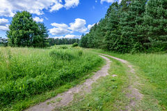 Empty road in the countryside. With trees and meadows in surrounding. perspective Stock Images