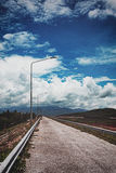 Empty road covered mountains Stock Photos