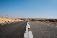 Empty road crossing the desert in israel stock photos