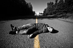 Empty Road With Dead Body in the Middle Royalty Free Stock Photography