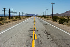 Empty road through the desert stock photos