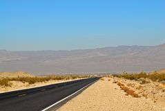 Empty road in desert Stock Photography