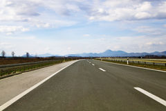 Empty road with distant mountains Stock Photography
