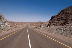 Empty road. Through dry rocky hills stock image