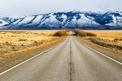 Empty road in El Calafate, Patagonia Argentina. Empty road in El Calafate with a snow mountain in the background, Patagonia Argentina royalty free stock images