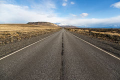 Empty road in El Calafate, Patagonia, Argentina. Empty road in El Calafate with a snow mountain in the background, Patagonia, Argentina Royalty Free Stock Image