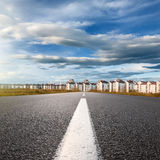 Empty road. Entry into the city at sunny day Royalty Free Stock Photo
