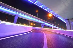 Empty road floor with city viaduct bridge of neon lights night Royalty Free Stock Photography