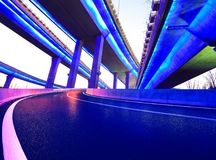 Empty road floor with city viaduct bridge of neon lights night Royalty Free Stock Images
