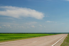 Empty Road Going Through Fields Royalty Free Stock Photos