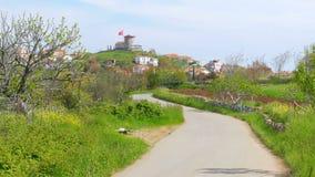 Empty road going to historical mill, cunda, ayvalik, turkey stock video footage