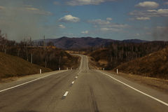 Empty road in a hilly area. Landscape. Royalty Free Stock Photos