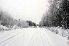 Empty road with huge snow banks on sides on cloudy winter day. Empty road with huge snow banks on sides on cloudy winter day stock photo