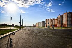 An empty road intersection of a new district of the city next to residential buildings on a sunny clear day against a cloudy sky. Grodno Belarus Stock Images
