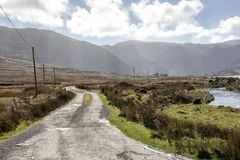 Empty Road Ireland 0006. Empty lakeside road in County Kerry on the west coast of Ireland Stock Images
