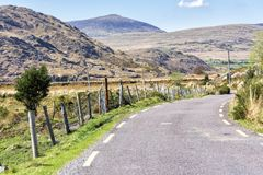 Empty Road Ireland 0012. Empty mountain road veering right, location west Kerry highlands off the Ring of Kerry, south west coast of Ireland royalty free stock photo